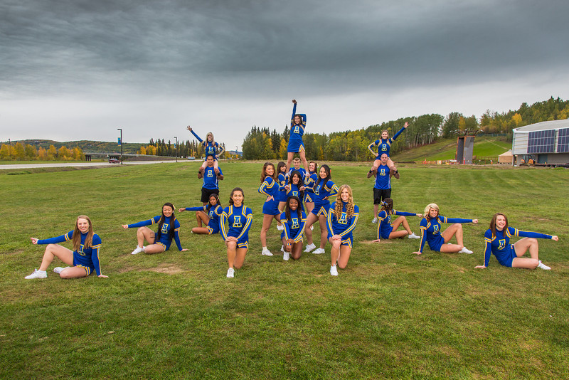 "UAF cheerleaders pose in front of the SRC on the Fairbanks campus.  <div class=""ss-paypal-button"">Filename: ATH-13-3943-29.jpg</div><div class=""ss-paypal-button-end"" style=""""></div>"