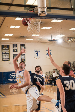 Senior Almir Hadzisehovic put up an off-balance shot from close distance during the Nanooks' 92-69 win over Concordia University Feb. 20 in the Patty Gym.  Filename: ATH-16-4810-56.jpg