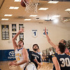 """Senior Almir Hadzisehovic put up an off-balance shot from close distance during the Nanooks' 92-69 win over Concordia University Feb. 20 in the Patty Gym.  <div class=""""ss-paypal-button"""">Filename: ATH-16-4810-56.jpg</div><div class=""""ss-paypal-button-end""""></div>"""