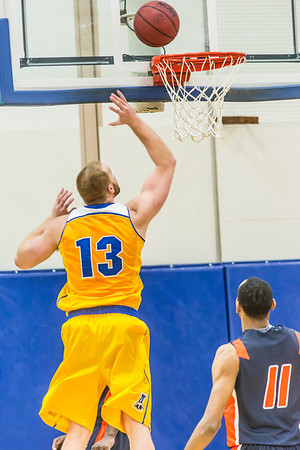 Senior forward Dallen Bills lays one off the glass in the first half of the Nanooks' 83-72 win over Fresno Pacific in the championship game of the GCI Alaska Invitational tournament in the Patty gym.  Filename: ATH-13-4005-31.jpg