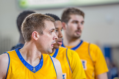 Nanooks' big men Stefan Tica, Andrew Kelly and Sergej Pucar hear instructions from the bench as they set up on an inbounds play during the Nanooks' 83-72 win over Fresno Pacific in the championship game of the GCI Alaska Invitational tournament.  Filename: ATH-13-4005-69.jpg