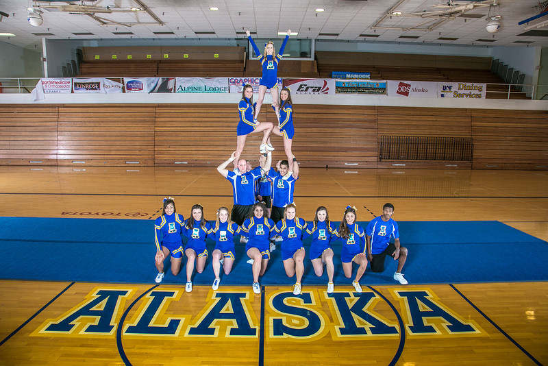 """The UAF cheerleading squad performs a variety of poses and routines during a practice session in the Patty Gym.  <div class=""""ss-paypal-button"""">Filename: ATH-13-3751-48.jpg</div><div class=""""ss-paypal-button-end"""" style=""""""""></div>"""