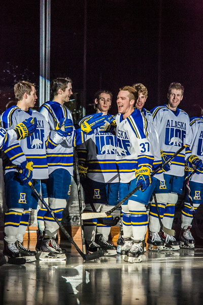 """Senior Cody Kunyk collects high fives from his teammates before his final regular season game as a Nanook before facing off against UAA Saturday, March 8 in the Carlson Center.  <div class=""""ss-paypal-button"""">Filename: ATH-14-4109-36.jpg</div><div class=""""ss-paypal-button-end""""></div>"""
