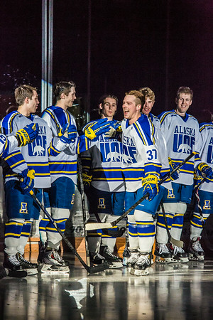 Senior Cody Kunyk collects high fives from his teammates before his final regular season game as a Nanook before facing off against UAA Saturday, March 8 in the Carlson Center.  Filename: ATH-14-4109-36.jpg