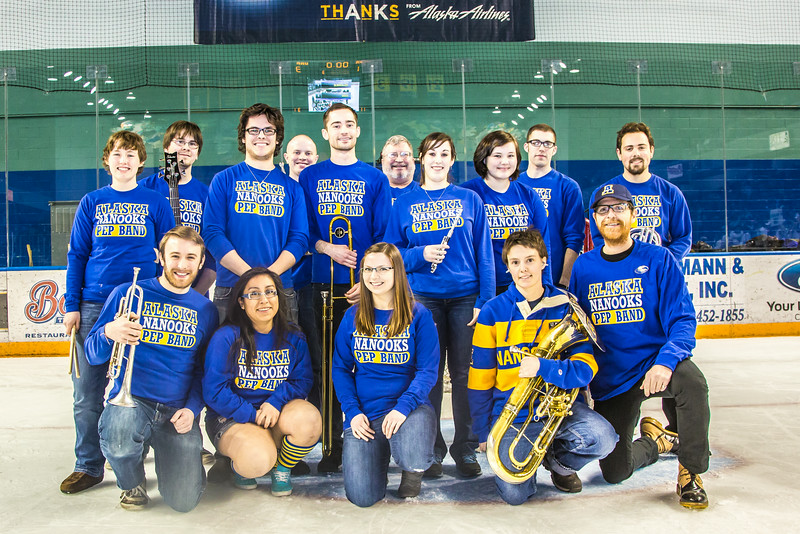 """The Nanooks Pep Band pose for a photo on the ice after a game in the Carlson Center.  <div class=""""ss-paypal-button"""">Filename: ATH-14-4109-330.jpg</div><div class=""""ss-paypal-button-end""""></div>"""