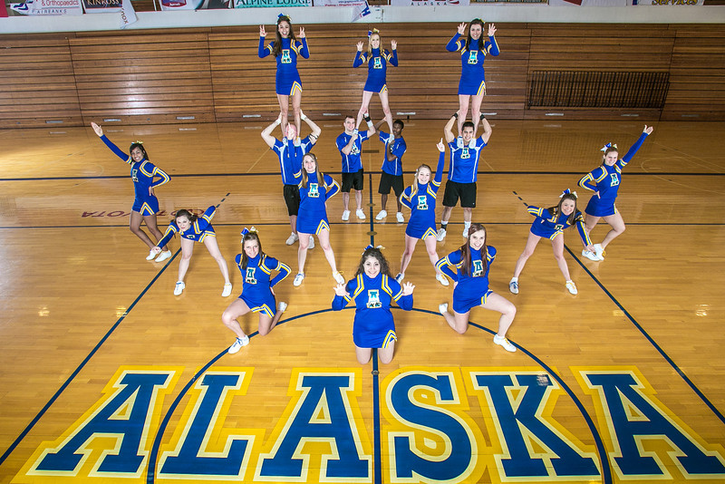 """The UAF cheerleading squad performs a variety of poses and routines during a practice session in the Patty Gym.  <div class=""""ss-paypal-button"""">Filename: ATH-13-3751-31.jpg</div><div class=""""ss-paypal-button-end"""" style=""""""""></div>"""