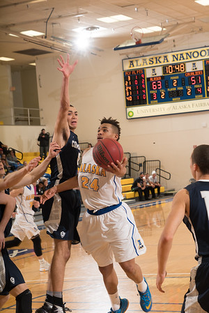 Senior Travante Williams scores on a scoop shot during the Nanooks' 92-69 win over Concordia University Feb. 20 in the Patty Gym.  Filename: ATH-16-4810-61.jpg