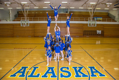 The 2014 Nanook cheerleaders pose in the Patty Gym.  Filename: ATH-14-4044-66.jpg