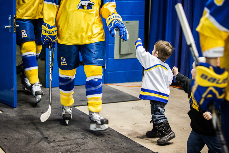 "Youngsters fist bump the UAF hockey players as they make their way to the ice rink at the Carlson Center.  <div class=""ss-paypal-button"">Filename: ATH-12-3676-106.jpg</div><div class=""ss-paypal-button-end"" style=""""></div>"