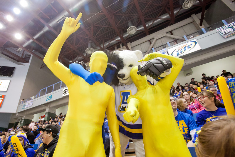 """Fans in the student section of the Carlson Center get into costume to support the Nanooks in their battle against the UAA Seawolves for the coveted Governor's Cup trophy.  <div class=""""ss-paypal-button"""">Filename: ATH-12-3304-165.jpg</div><div class=""""ss-paypal-button-end"""" style=""""""""></div>"""