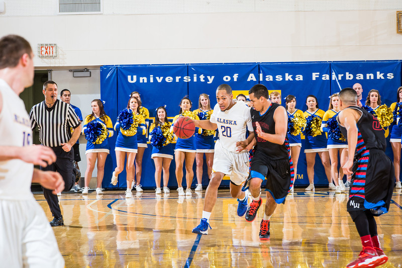 """Joe Slocum pushes the ball up the court during the Nanooks' game against Northwest Indian College in the Patty Center.  <div class=""""ss-paypal-button"""">Filename: ATH-13-4034-44.jpg</div><div class=""""ss-paypal-button-end"""" style=""""""""></div>"""