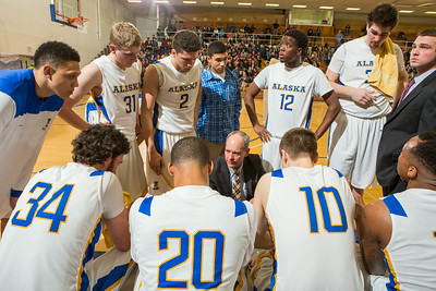 Head Coach Mick Durham counsels his team at a game against University of Alaska Fairbanks at the Patty Gym.  Filename: ATH-14-4098-248.jpg