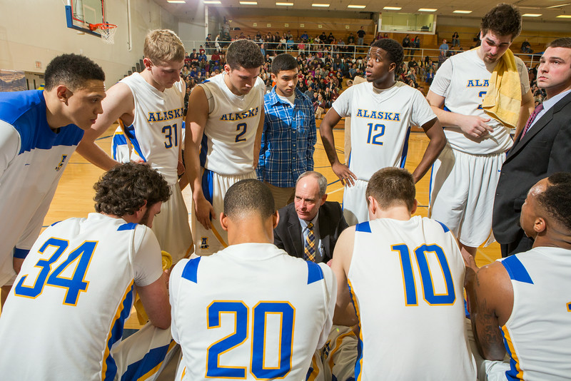 """Head Coach Mick Durham counsels his team at a game against University of Alaska Fairbanks at the Patty Gym.  <div class=""""ss-paypal-button"""">Filename: ATH-14-4098-248.jpg</div><div class=""""ss-paypal-button-end""""></div>"""