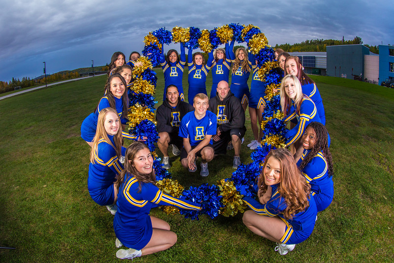 """UAF cheerleaders pose in front of the SRC on the Fairbanks campus.  <div class=""""ss-paypal-button"""">Filename: ATH-13-3943-149.jpg</div><div class=""""ss-paypal-button-end"""" style=""""""""></div>"""