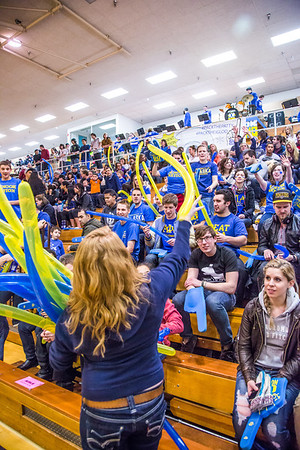 UAF Traditions student Katie Griffin tosses balloons into the crowd before the Nanooks hosted the rival UAA Seawolves in the Patty Center.  Filename: ATH-13-3700-27.jpg