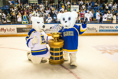 Nanook mascots big and small pose with the Governor's Cup.  Filename: ATH-14-4109-337.jpg