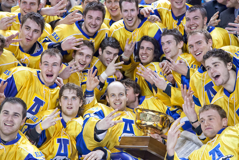 "The UAF hockey team huddles around the Governor's Cup on the ice in the Carlson Center after their thrilling victory over the UAA Seawolves to claim the coveted trophy for the third time in the past four years.  <div class=""ss-paypal-button"">Filename: ATH-12-3304-338.jpg</div><div class=""ss-paypal-button-end"" style=""""></div>"