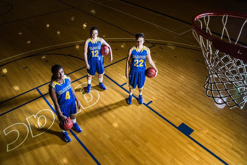 """Sophomores Benissa Bulaya, left, and Kelly Logue, center, join senior Jacqueline Lovato on the Patty Center court.  <div class=""""ss-paypal-button"""">Filename: ATH-12-3625-001.jpg</div><div class=""""ss-paypal-button-end"""" style=""""""""></div>"""