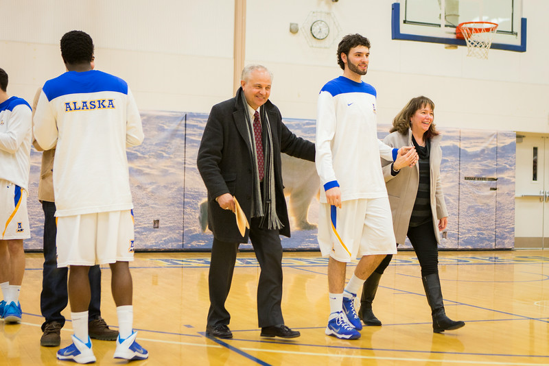 """Basketball player Mike Stepovich is accompanied by his parents as he is recognized during senior night at game against University of Alaska Fairbanks  <div class=""""ss-paypal-button"""">Filename: ATH-14-4098-54.jpg</div><div class=""""ss-paypal-button-end""""></div>"""