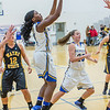 """Point guard Benissa Bulaya puts up a jump shot during the first half of the championship game of the North Star Invitational Tournament against Wayne State in the Patty Gym.  <div class=""""ss-paypal-button"""">Filename: ATH-13-4010-20.jpg</div><div class=""""ss-paypal-button-end"""" style=""""""""></div>"""