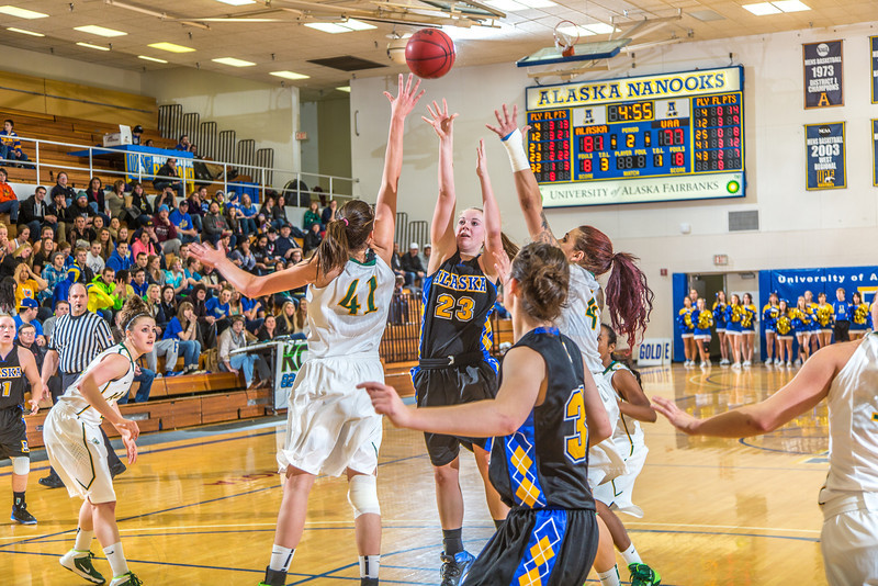 """Freshman Jordan Wilson shoots over the defense during the second half of the Nanooks game against the rival Seawolves from UAA Jan. 18 in the Patty Gym.  <div class=""""ss-paypal-button"""">Filename: ATH-14-4041-51.jpg</div><div class=""""ss-paypal-button-end"""" style=""""""""></div>"""