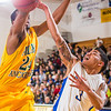 "Senior guard Dominique Brinson tries to get off a shot inside during the Nanooks game against the UAA Seawolves in the Patty Center.  <div class=""ss-paypal-button"">Filename: ATH-13-3700-120.jpg</div><div class=""ss-paypal-button-end"" style=""""></div>"