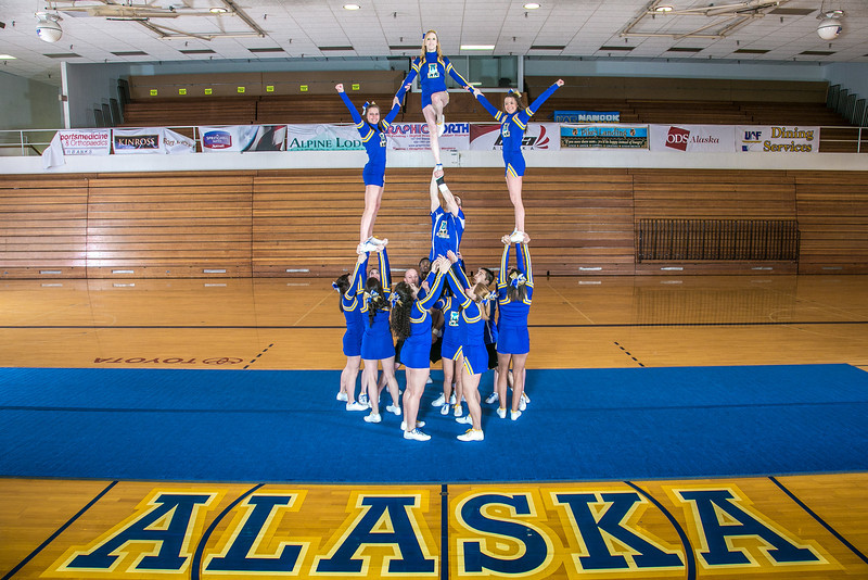 """The UAF cheerleading squad performs a variety of poses and routines during a practice session in the Patty Gym.  <div class=""""ss-paypal-button"""">Filename: ATH-13-3751-53.jpg</div><div class=""""ss-paypal-button-end"""" style=""""""""></div>"""