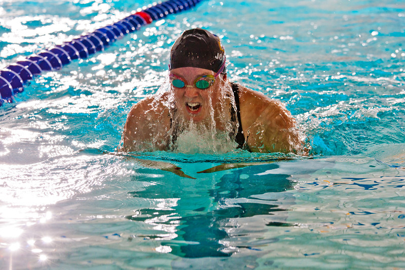 """Freshman Genevieve Johnson nears the finish before winning the 100-yard breast stroke event for the Nanooks during their dual meet against Colorado Mesa in the Patty pool.  <div class=""""ss-paypal-button"""">Filename: ATH-12-3267-180.jpg</div><div class=""""ss-paypal-button-end"""" style=""""""""></div>"""