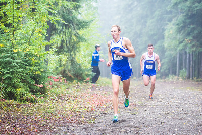 Max Olex races toward the finish line at a meet against Montana State University Billings and Seattle Pacific University on a foggy Saturday morning on campus.  Filename: ATH-13-3933-40.jpg