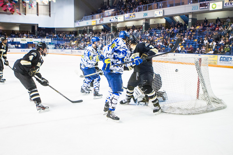 """UAF Mens Hockey Team sports on blue camouflage jerseys as part of a 10-day military appreciation event hosted by the Alaska Nanooks at a game against Western Michigan Nov. 16, 2012 at the Carlson Center.  <div class=""""ss-paypal-button"""">Filename: ATH-12-3656-61.jpg</div><div class=""""ss-paypal-button-end"""" style=""""""""></div>"""