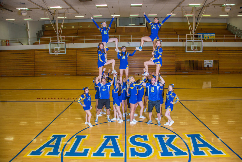 """The 2014 Nanook cheerleaders pose in the Patty Gym.  <div class=""""ss-paypal-button"""">Filename: ATH-14-4044-63.jpg</div><div class=""""ss-paypal-button-end"""" style=""""""""></div>"""