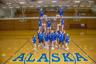 The 2014 Nanook cheerleaders pose in the Patty Gym.  Filename: ATH-14-4044-63.jpg