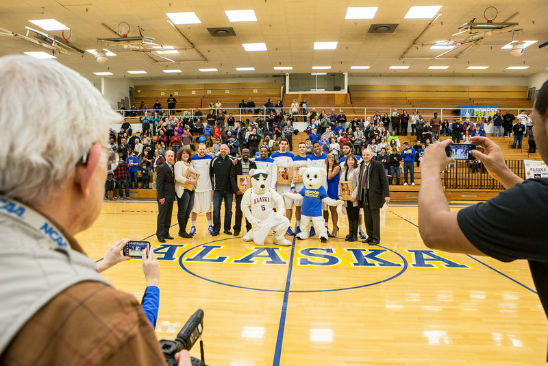 """Nanooks Mens Basketball Seniors and their parents are recognized before a game against University of Alaska Anchorage at the Patty Gym.  <div class=""""ss-paypal-button"""">Filename: ATH-14-4098-106.jpg</div><div class=""""ss-paypal-button-end""""></div>"""