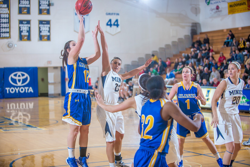 """Sophomore Kelly Logue puts up a shot during second half action in the Nanooks' game against the Colorado School of Mines in the Patty Center.  <div class=""""ss-paypal-button"""">Filename: ATH-12-3639-106.jpg</div><div class=""""ss-paypal-button-end"""" style=""""""""></div>"""