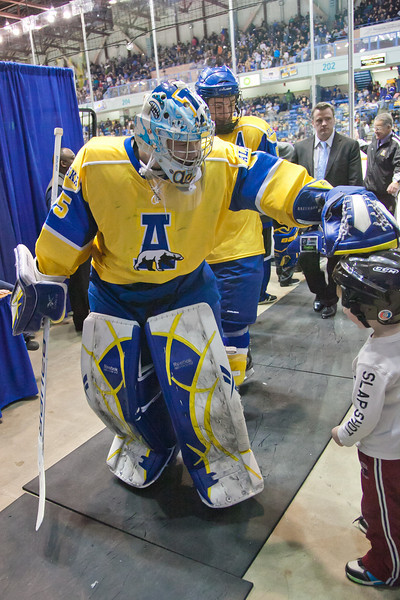 "Goalie Scott Greenham stops on the way to the locker room between periods to interact with a young fan in the Carlson Center.  <div class=""ss-paypal-button"">Filename: ATH-12-3304-113.jpg</div><div class=""ss-paypal-button-end"" style=""""></div>"