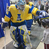 """Goalie Scott Greenham stops on the way to the locker room between periods to interact with a young fan in the Carlson Center.  <div class=""""ss-paypal-button"""">Filename: ATH-12-3304-113.jpg</div><div class=""""ss-paypal-button-end"""" style=""""""""></div>"""
