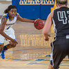 """Point guard Benissa Bulaya looks for an opening in the defense during a game against Montana State Billings.  <div class=""""ss-paypal-button"""">Filename: ATH-13-3720-12.jpg</div><div class=""""ss-paypal-button-end"""" style=""""""""></div>"""