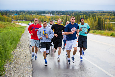 Members of the Nanook basketball team get in a workout running up Tanana Loop on a recent rainy afternoon.  Filename: ATH-12-3535-17.jpg
