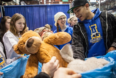 The Student-Athlete Advisory Committee (SAAC) sponsored the 2nd Annual Teddy Bear Toss during the hockey game against Bowling Green State University Saturday, Dec. 8, 2012 at the Carlson Center. The bears were sent to Santa's Clearing House in Fairbanks to be given to families during holiday season.  Filename: ATH-12-3676-82.jpg