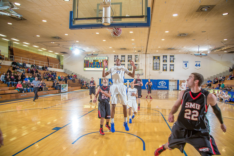 """Junior forward Andrew Kelly makes sure his shot stays in after scoring on a fast break during the second half of the Nanooks' 81-58 win over Saint Martin's Jan. 10 in the Patty Center.  <div class=""""ss-paypal-button"""">Filename: ATH-13-3695-75.jpg</div><div class=""""ss-paypal-button-end"""" style=""""""""></div>"""