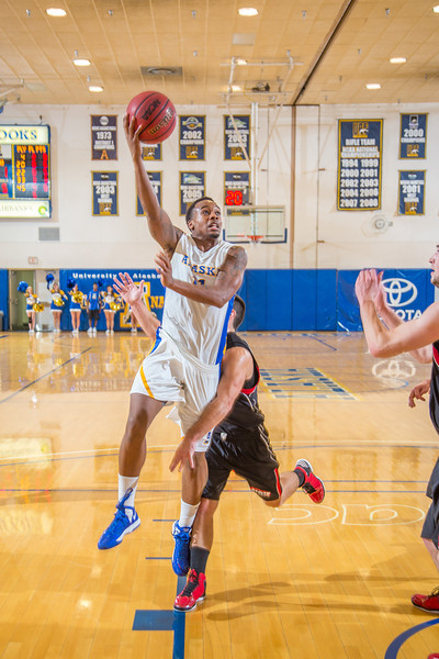 """Junior guard Ronnie Baker gets past his man and puts up a short bank shot during the second half of the Nanooks' 81-58 win over Saint Martin's Jan. 10 in the Patty Center.  <div class=""""ss-paypal-button"""">Filename: ATH-13-3695-55.jpg</div><div class=""""ss-paypal-button-end"""" style=""""""""></div>"""