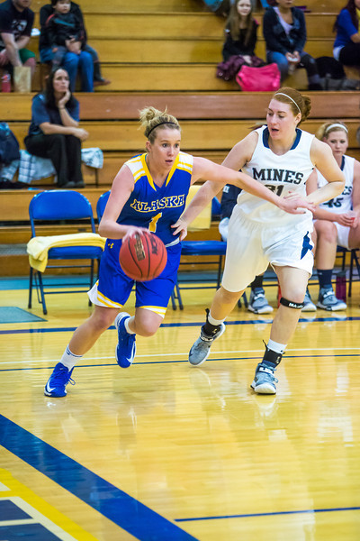 """Senior Taylor Altenburg drives the baseline during first half action in the Nanooks' game against the Colorado School of Mines in the Patty Center.  <div class=""""ss-paypal-button"""">Filename: ATH-12-3639-12.jpg</div><div class=""""ss-paypal-button-end"""" style=""""""""></div>"""