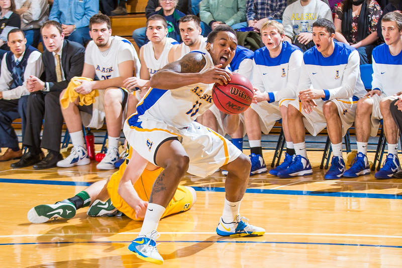 """Junior guard Ronnie Baker sheds his defender during the Nanooks game against the UAA Seawolves in the Patty Center.  <div class=""""ss-paypal-button"""">Filename: ATH-13-3700-169.jpg</div><div class=""""ss-paypal-button-end"""" style=""""""""></div>"""