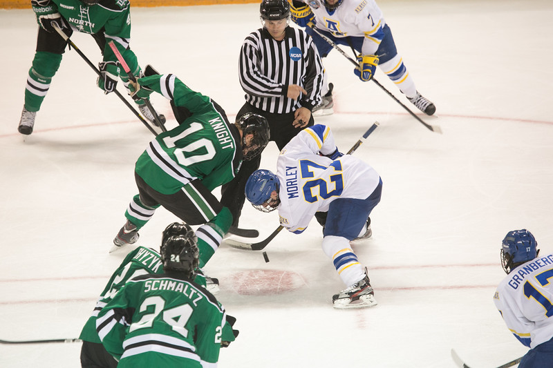 "Freshman Tyler Morley faces off against an opponent during the Nanooks' 2-1 win over North Dakota in the Carlson Center.  <div class=""ss-paypal-button"">Filename: ATH-12-3601-179.jpg</div><div class=""ss-paypal-button-end"" style=""""></div>"