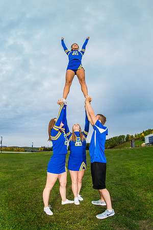 UAF cheerleaders strike a pose in front of the SRC on the Fairbanks campus.  Filename: ATH-13-3943-82.jpg