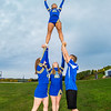 "UAF cheerleaders strike a pose in front of the SRC on the Fairbanks campus.  <div class=""ss-paypal-button"">Filename: ATH-13-3943-82.jpg</div><div class=""ss-paypal-button-end"" style=""""></div>"