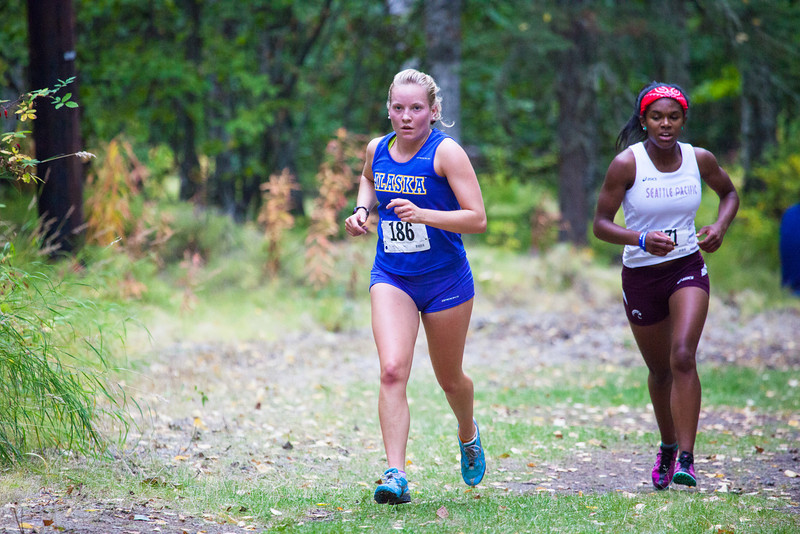 """Senior Heather Edic races to the finish line during a cross country meet Thursday, August 30, 2012 on the UAF West Ridge ski trails.  <div class=""""ss-paypal-button"""">Filename: ATH-12-3530-20.jpg</div><div class=""""ss-paypal-button-end"""" style=""""""""></div>"""