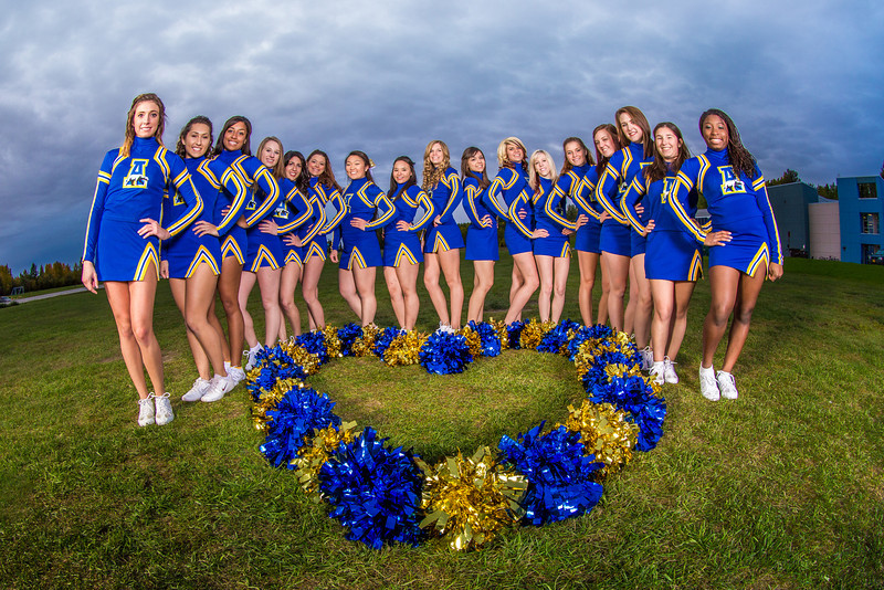 "UAF cheerleaders pose in front of the SRC on the Fairbanks campus.  <div class=""ss-paypal-button"">Filename: ATH-13-3943-143.jpg</div><div class=""ss-paypal-button-end"" style=""""></div>"