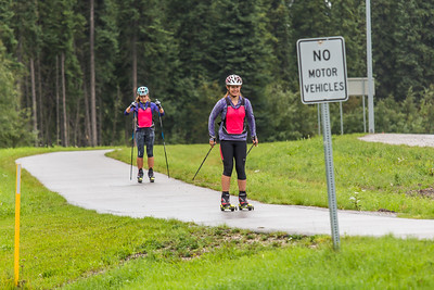 Members of UAF's cross-country ski team get in a late-summer workout along the campus bike trails.  Filename: ATH-15-4607-05.jpg