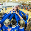 "The Nanooks huddle up before the opening serve in the 2013 Nanook Classic tournament in the Patty Center.  <div class=""ss-paypal-button"">Filename: ATH-13-3930-1.jpg</div><div class=""ss-paypal-button-end""></div>"